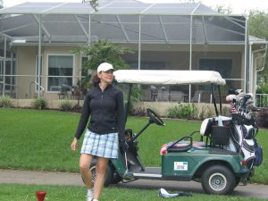 wife playing golf with husband
