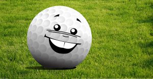 A golf ball with a smiley face.